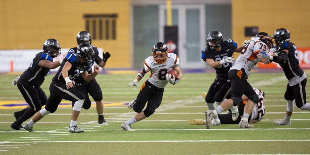Running the ball during a football game
