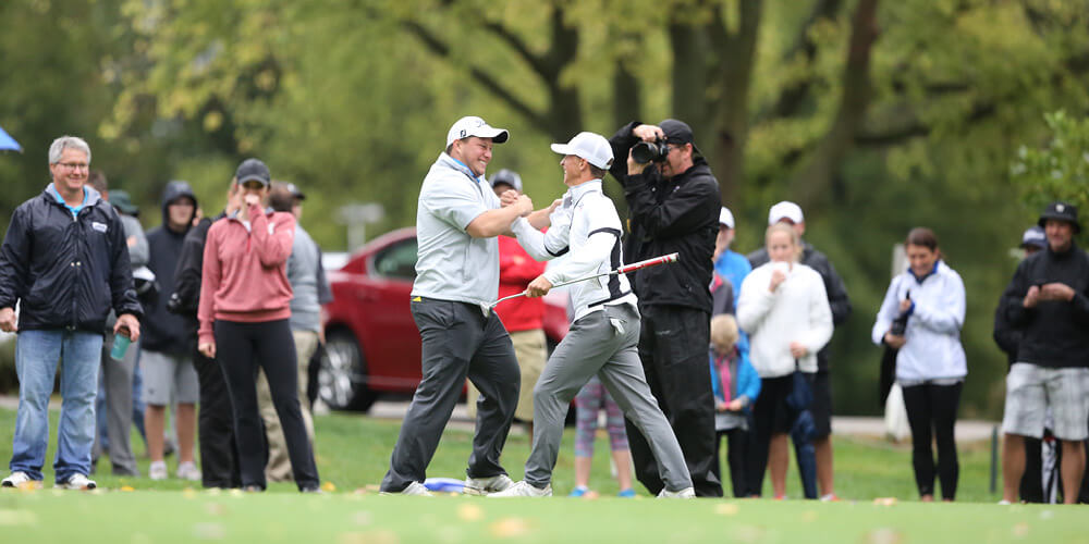Shaking hands in celebration during a golf meet