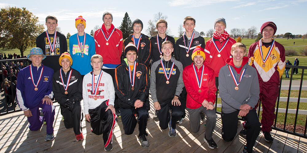 IHSAA XC champions posing for a photo
