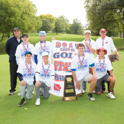 Golf champions posing with their trophy