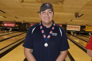 IHSAA Xavier bowling champion posing for a photo