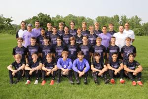 Waukee soccer team posing for a photo