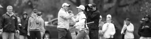 Two people celebrating a during a golf meet