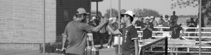 Black and white image of two baseball players shaking hands