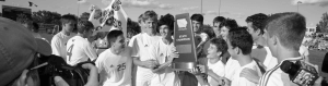 Black and white photo of state champions celebrating
