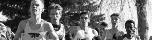 Young men running during a cross country meet