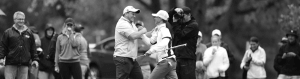 Image of two men sharing a handshake during a game of golf