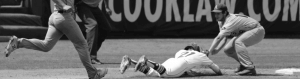 Player sliding into a base during a game of baseball