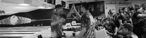 Two bowling players giving each other a high-five at a bowling match