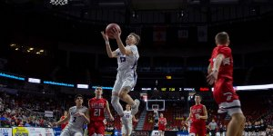 Norwalk basketball player mid-air