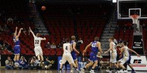 Basketball player mid-air shooting the ball