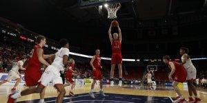 Cedar Falls basketball player shooting the ball mid-air