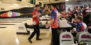 Celebrating with a high five during a bowling game
