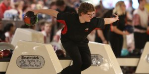 Action shot of a high school student during a bowling match