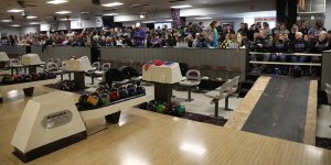 Friends and family watching a bowling match