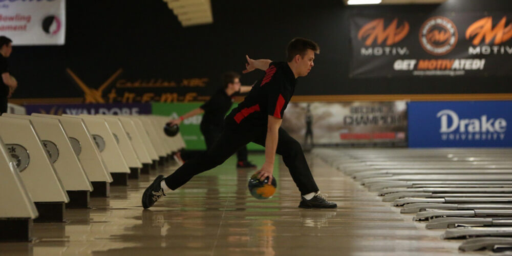 Wide shot of a player during a bowling match