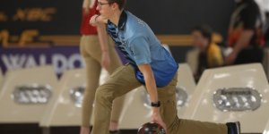 Mid-throw during a bowling game