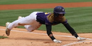 Baseball player sliding into a base during a game
