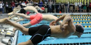 Close up shot of a swimmer diving into the water
