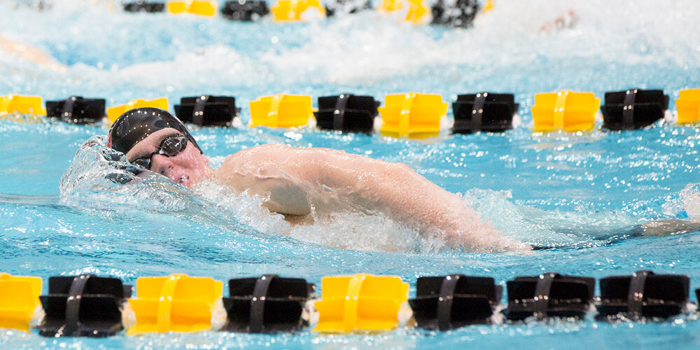 Swimmers turning mid stroke in a meet