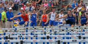 Running over hurdles during a track meet