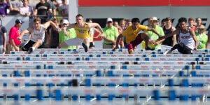 Running over hurdles at a IHSAA meet