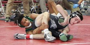 Two students on the ground during a wrestling match