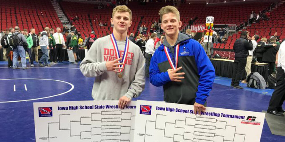 Two IHSAA Wrestlers pose for a photo with their medals