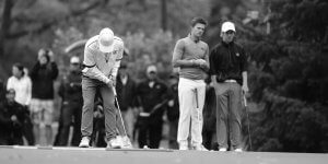 Image of a young man putting during a game of golf