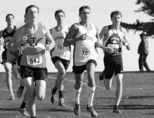 Image of a young man running in xc