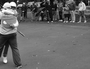 Image of two guys hugging during a round of golf