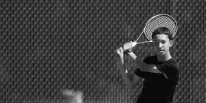 Image of a young man playing tennis